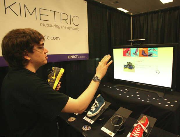 Alejandro Muther, CEO of Kimetric, demonstrates his company's system, which monitors shoppers, giving them product details and suggestions, at the Microsoft Accelerator for Kinect exhibition in Redmond on Thursday, June 28, 2012. Photo: Aubrey Cohen/seattlepi.com Staff