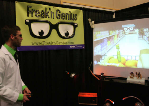 "Kyle Kesterson, founder and CEO of Freak'n Genius, shows off his system, which lets people instantly create 2D animations, at the Microsoft Accelerator for Kinect exhibition in Redmond on Thursday, June 28, 2012. ""We're making it so anybody can animate,"" Founder and CEO Kyle Kesterson said. ""You use your body and you use your face and you use your voice. ... We actually started trying to create our own cartoon about a talking tapeworm and then we realized that animation's really hard.""