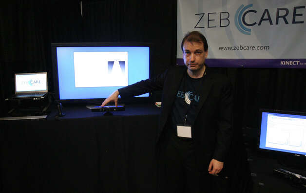 "Zeb Kimmel, founder and CEO of Zebcare, shows off his system, which monitors seniors for health issues, at the Microsoft Accelerator for Kinect exhibition in Redmond on Thursday, June 28, 2012. ""What we're trying to do is keep older people independent and safe at home,"" Kimmel said. The system tracks movement (or lack of it), looks for warning signs and provides information to friends or family members, but doesn't record video or pictures, he said. ""We can share all sorts of information in a way that completely respects your privacy."" Photo: Aubrey Cohen/seattlepi.com Staff"