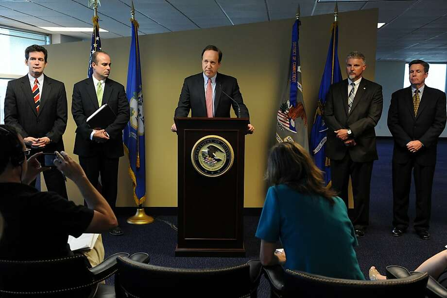 U.S. Attorney David B. Fein speaks at a news conference in Bridgeport, Conn., Thursday, June 28, 2012.  A division of United Technologies Corp. pleaded guilty Thursday to crimes related to the illegal export of software that U.S. officials say was used by China to develop the country's first modern military attack helicopter. The subsidiary, Pratt & Whitney Canada Corp.; Hartford, Conn.-based UTC; and another subsidiary also agreed to pay more than $75 million in fines in connection with the export violations and for providing misleading information to the U.S. government.  Fein, said Pratt & Whitney Canada knowingly committed the violations because it wanted to become the exclusive supplier for a helicopter market in China with projected revenues of up to $2 billion. (AP Photo/The Connecticut Post, Ned Gerard) Photo: Ned Gerard, Associated Press
