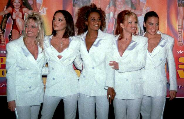 "The Spice Girls pose at the premiere of their movie ""Spice World"" in Hollywood, Calif., on Jan. 22, 1998. From left: Emma Bunton (Baby Spice), Victoria Adams (Posh Spice), Melanie Brown (Scary Spice), Geri Halliwell (Ginger Spice) and Melanie Chisholm (Sporty Spice). Photo: AP Photo/Michael Tweed"