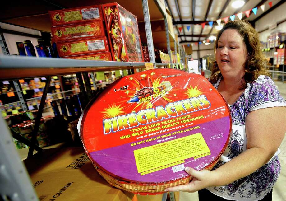 Stroud's fireworks is located just outside Nederland on Twin City Highway.  Shelley Metts, one of the owners talks about the fireworks business and what is new this season considering there isn't a burn ban this year.  Massive rolls of firecrackers, such as this one containing 16,000 1 1/2 inch of the firework are very popular. Dave Ryan/The Enterprise