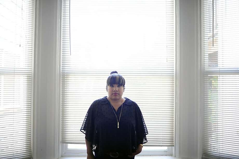 Edith Gonzales poses for a portrait in her home in the Mission District of San Francisco, CA June 28th, 2012. Edith owes over $100,000 from an emergency gal bladder surgery claim that her insurance company has denied. Photo: Michael Short, Special To The Chronicle