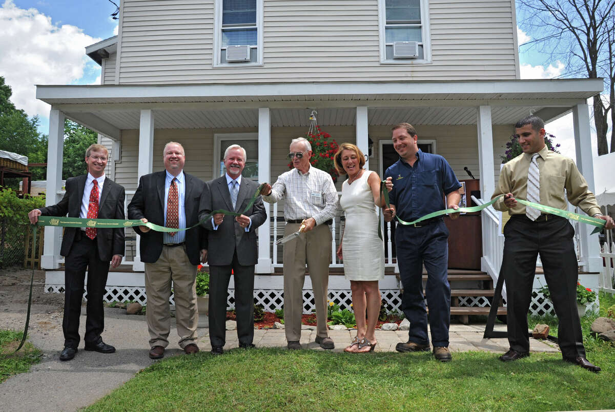City officials and organizers participate in a ribbon cutting at 20 Walworth St. Thursday, June 28, 2012 in Saratoga Springs, N.Y. SOS has undertaken the expansion of an adjacent facility which will add 13 shelter beds at 20 Walworth Street, which had previously been used for a transitional housing pilot program. (Lori Van Buren / Times Union)