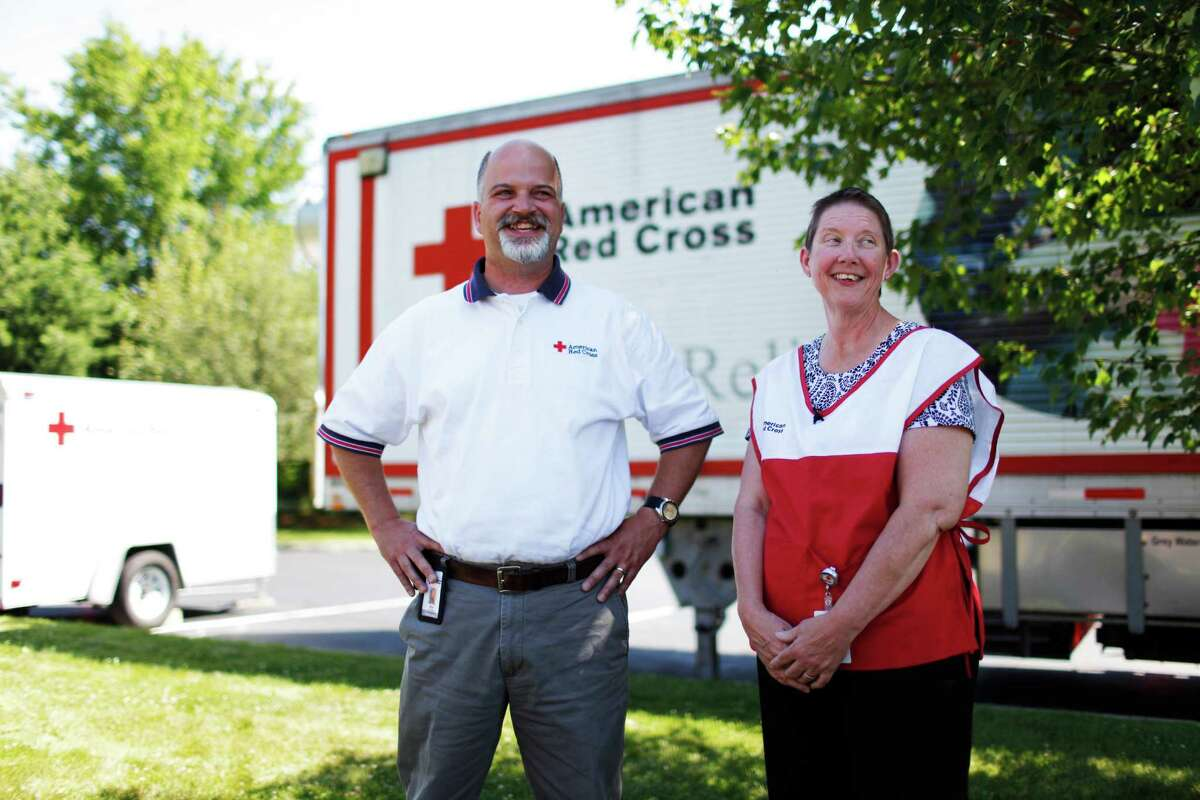 Local American Red Cross Northeastern New York (ARCNENY) Director of Volunteer & Community Services Skip Zimmerman, left, and Disaster Volunteer Associate Kathryn Smith, right, talk to the media outside of the ARCNENY office, in Albany, N.Y., Thursday, June 28, 2012. The two volunteers are being sent to Loveland, CO to help with the disaster relief efforts following the destruction caused by recent wildfires. (Dan Little / Special to the Times Union)