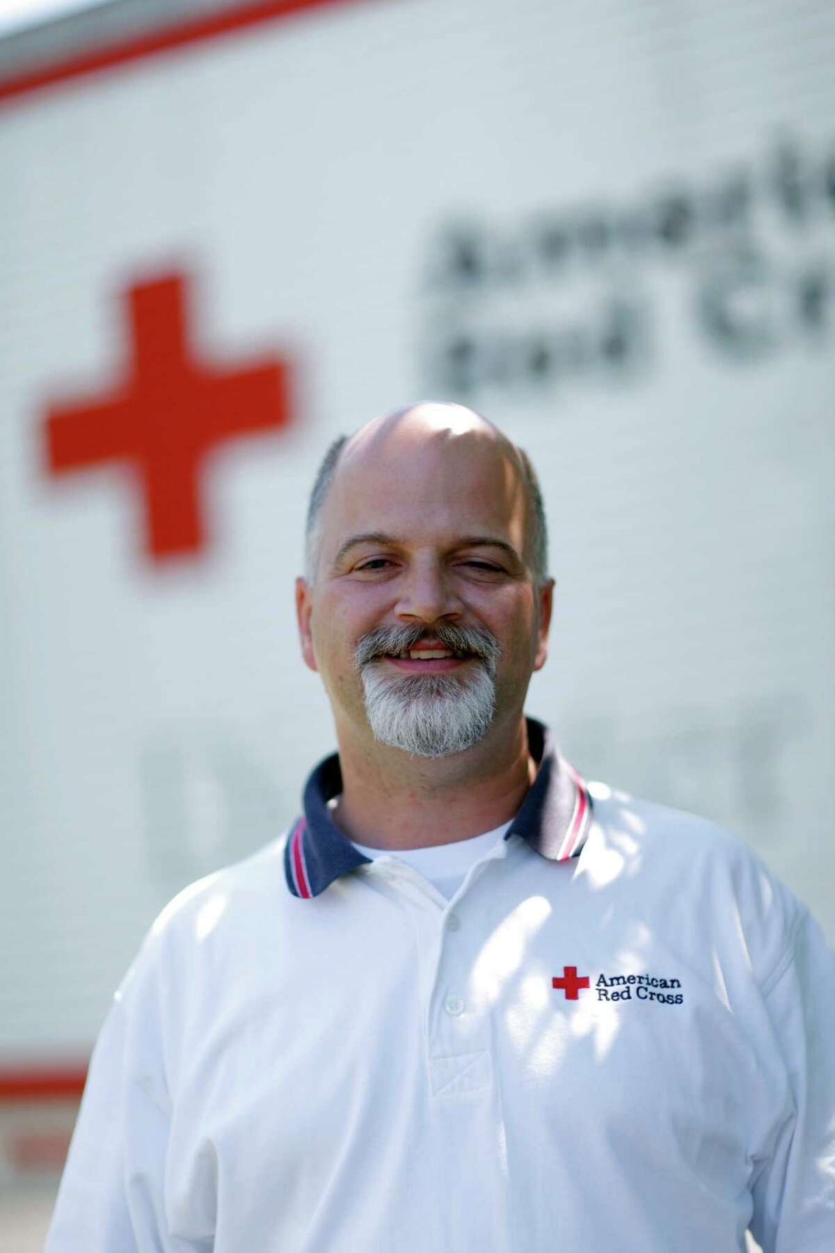 Local American Red Cross Northeastern New York (ARCNENY) Director of Volunteer & Community Services Skip Zimmerman, poses for a photo outside of the ARCNENY office, in Albany, N.Y., Thursday, June 28, 2012. Two volunteers, Skip Zimmerman and Kathryn Smith, are being sent to Loveland, CO to help with the disaster relief efforts following the destruction caused by recent wildfires. (Dan Little / Special to the Times Union)