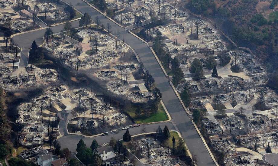 This aerial photo shows the destructive path of the Waldo Canyon fire in the Mountain Shadows subdivision of Colorado Springs, Colo., Thursday, June 28, 2012. Photo: RJ Sangosti, Associated Press / (C) 2012 The Denver Post, MediaNews Group