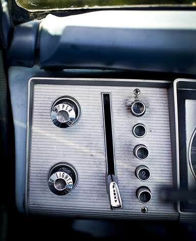 The push-button gear shifter of Lily Fighera's 1963 Dodge Dart is seen on Tuesday, June 26, 2012 in San Francisco, Calif.  Her husband, Mark, gave her the car as an engagement gift. Photo: Russell Yip, The Chronicle