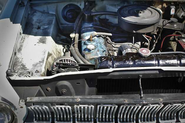 The engine of Lily Fighera's 1963 Dodge Dart is seen on Tuesday, June 26, 2012 in San Francisco, Calif.  Her husband, Mark, gave her the car as an engagement gift. Photo: Russell Yip, The Chronicle