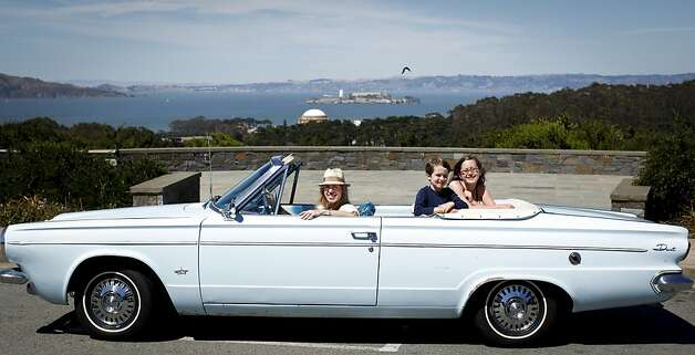 Lily Fighera, left, poses with her 1963 Dodge Dart with her son, Dominic, 5, and daughter, Sofia, 9,  on Tuesday, June 26, 2012 in San Francisco, Calif. Photo: Russell Yip, The Chronicle