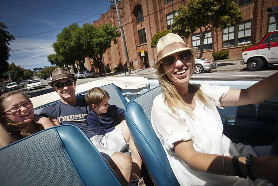 Lily Fighera drives her 1963 Dodge Dart with her daughter, Sofia, 9, husband, Mark, and son, Dominic, 5, on Tuesday, June 26, 2012 in San Francisco, Calif.  Mark gave her the car as an engagement gift. Photo: Russell Yip, The Chronicle