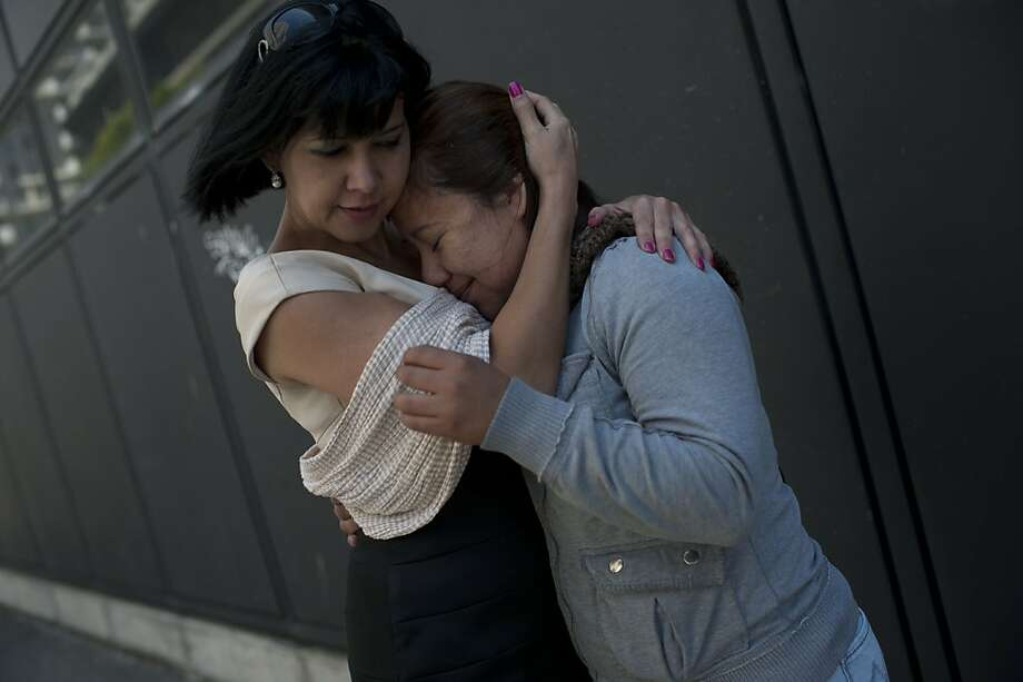 Alessandra Lacerda, left, interpreter, embraces Blanca Medina before Medina's attorney delivered a petition at the Immigration and Customs Enforcement field office on Thursday, June 28, 2012 in San Francisco, Calif. Medina suffers from post-traumatic stress disorder from being raped four times in her native country of El Salvador and a fifth time on her way across the border to the United States in 2005. Medina's attorney, Matt Muller, successfully had her deportation postponed pending a later hearing to discuss her asylum case. Photo: Yue Wu, The Chronicle