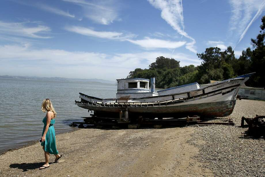 China Camp visitor Remy Wilson walks past one of the old shrimping boats on display on the beach. California State Senator Joe Simitian has unveiled a plan to save state parks including the popular China Camp State Park in Marin County, Calif. Photo: Brant Ward, The Chronicle