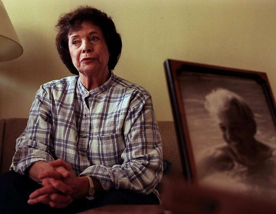Screenwriter Joan Scott, wife of blacklisted writer Adrian Scott (portrait at right), in a 1997 file photo. Joan Scott died June 19, 2012, at 91. (Robert Durell/Los Angeles Times/MCT) Photo: Robert Durell, McClatchy-Tribune News Service