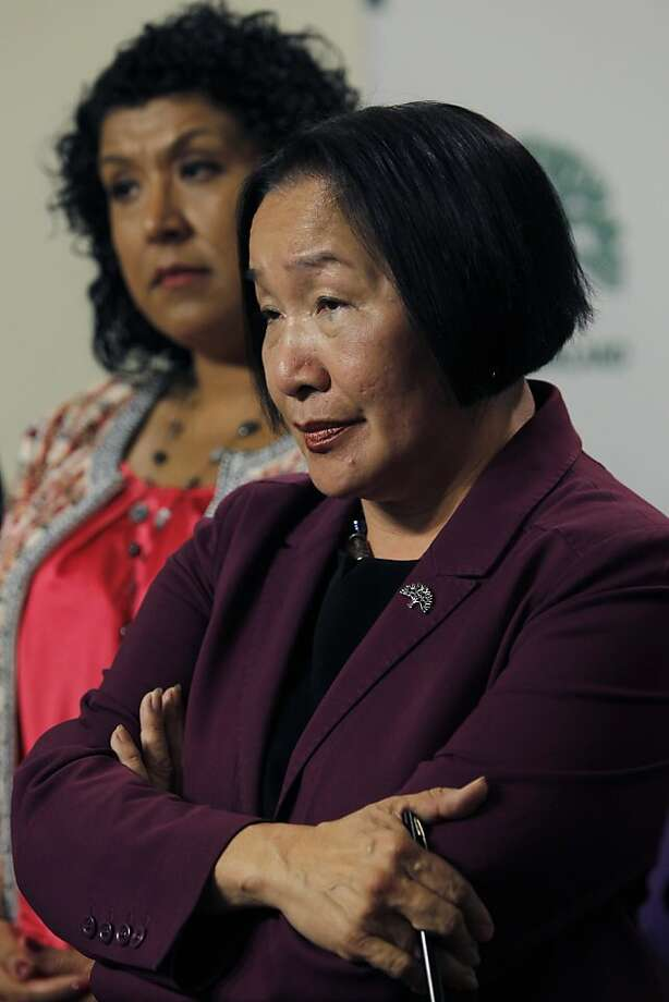 Oakland Mayor Jean Quan admits erroneous statistical data was used to implement her controversial 100 Blocks anti-crime plan but defended the program at a City Hall news conference in Oakland, Calif. on Wednesday, June 27, 2012. City Administrator Deanna Santana (left) appeared with the mayor. Photo: Paul Chinn, The Chronicle