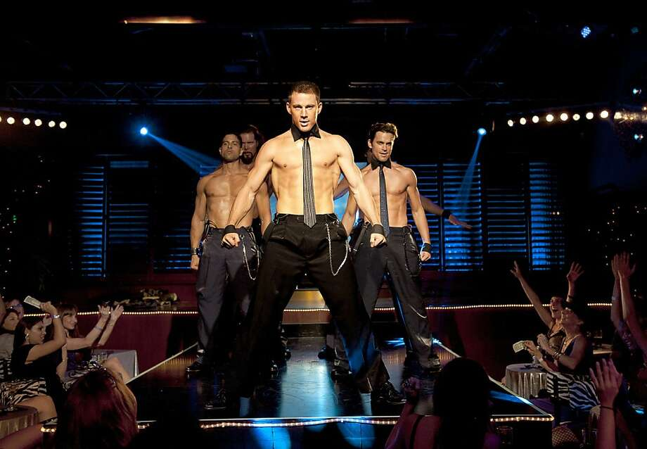 "This film image released by Warner Bros. shows, from left, Adam Rodriguez, Kevin Nash, Channing Tatum, and Matt Bomer in a scene from ""Magic Mike."" Matthew McConaughey, Channing Tatum, Alex Pettyfer, Joe Manganiello and Matt Bomer play fire men, cops and other exaggerated versions of hyper-masculine characters in the Steven Soderbergh film, and they say preparing for their parts and performing nearly nude for the dozens of female extras who populated the fake Club Xquisite gave the actors insight into women's grooming, undergarments and approach to carnal fantasy. (AP Photo/Warner Bros., Claudette Barius) Photo: Claudette Barius, Associated Press"
