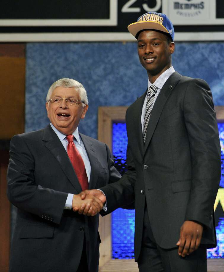 NBA Commissioner David Stern, left, poses with the No. 7 overall draft pick Harrison Barnes, of North Carolina, who was selected by the Golden State Warriors in the NBA basketball draft, Thursday, June, 28, 2012, in Newark, N.J. (AP Photo/Bill Kostroun) Photo: Bill Kostroun, Associated Press