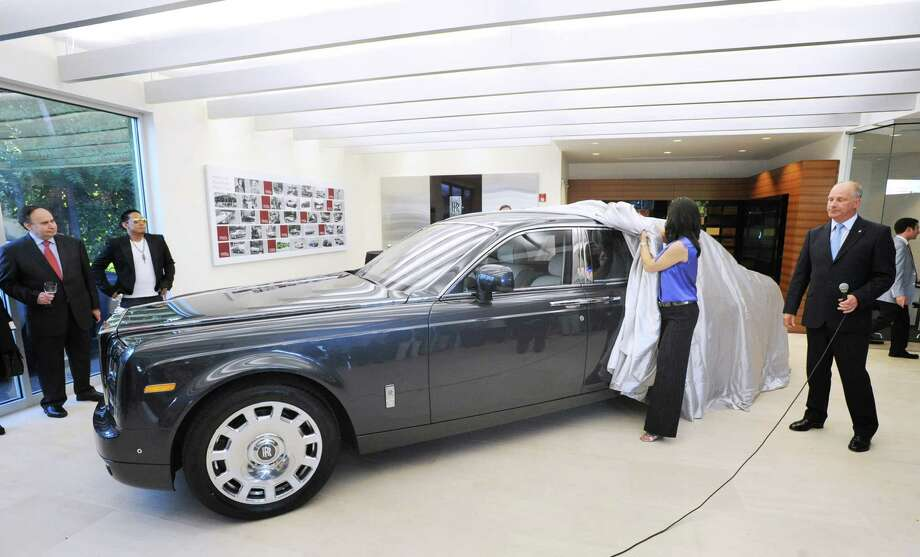 At right, David Archibald, president of Rolls-Royce Motor Cars North America, during the unveiling ceremony of the Rolls-Royce Phantom Series II in the recently renovated showroom at Rolls-Royce Motor Cars Greenwich Wednesday night, June 27, 2012. Photo: Bob Luckey / Greenwich Time