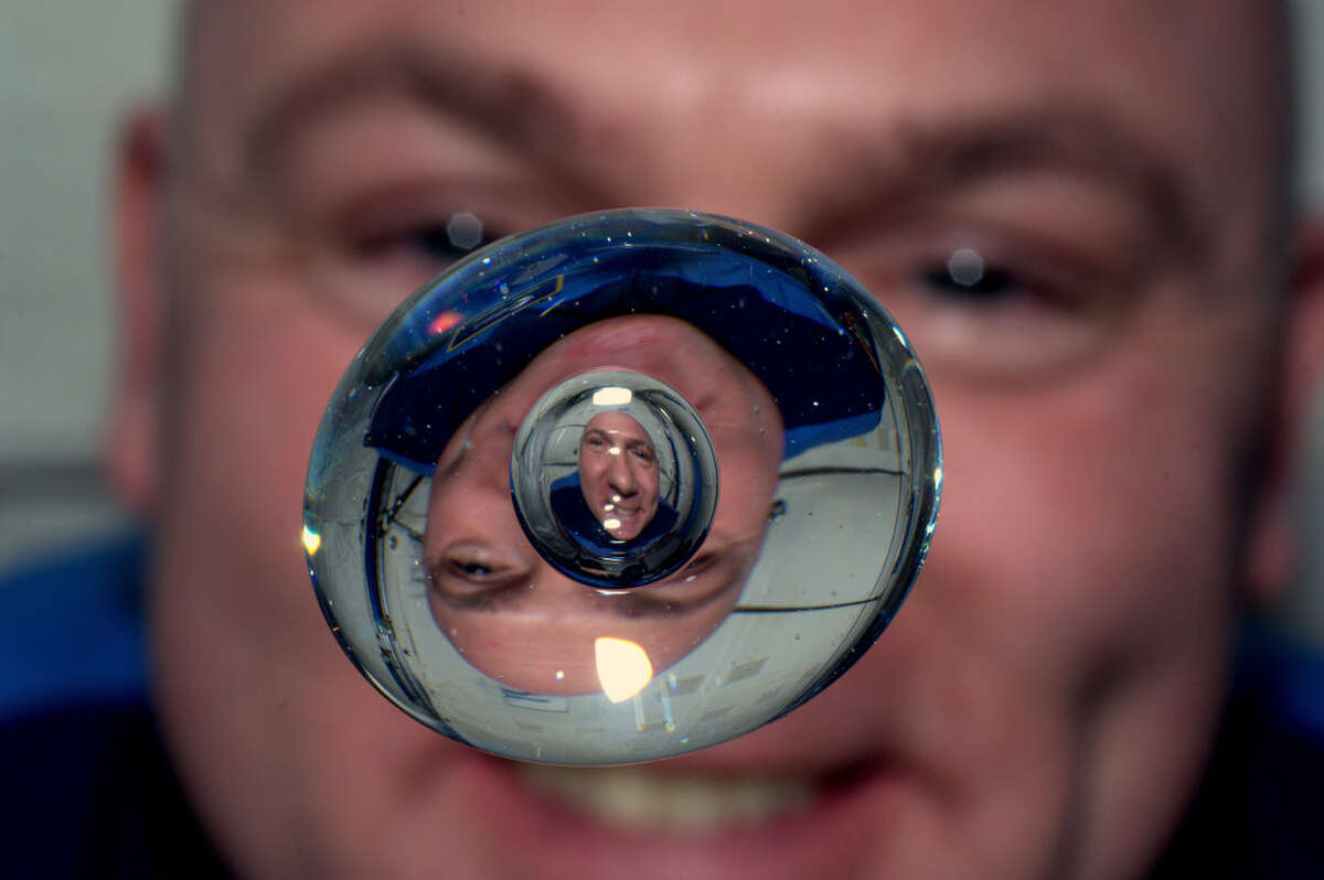 In this image provided by NASA astronaut Andre Kuipers watches a bubble in a drop of water as he enjoys the last days of weightlessness. The photo was taken June 24, 2012. Astronauts Oleg Kononenko, Andre Kuipers, Don Pettit are due to return to earth on board the Soyuz TMA-03M set for landing on July 1, 2012. (AP Photo/NASA, Andre Kuipers)