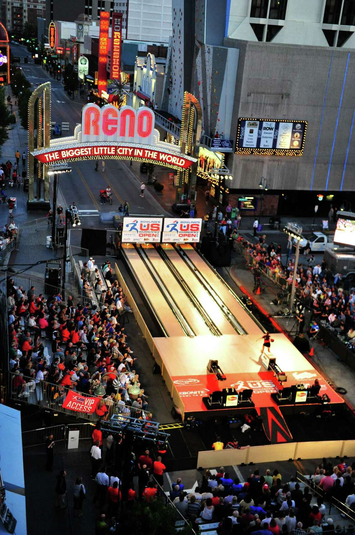 In this photo provided by the Bowling Proprietors' Association of America, professional sports history was made Wednesday night June 27, 2012 when Bowling?'s U.S. Women?'s Open was held outdoors on Virginia Street under the iconic Reno Arch in Reno, Nev. Kelly Kulick of Union, N.J., defeated Missy Parkin of Lake Forest, Calif., to win the major title. (AP Photo/BPAA, Tim Dunn)
