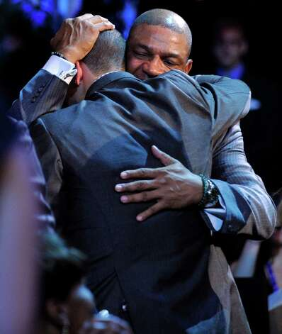 Boston Celtics head coach Doc Rivers, rear, hugs his son, Duke's Austin Rivers, after Austin was selected as the No. 10 overall draft pick by the New Orleans Hornets in the NBA basketball draft, Thursday, June, 28, 2012, in Newark, N.J. Photo: AP