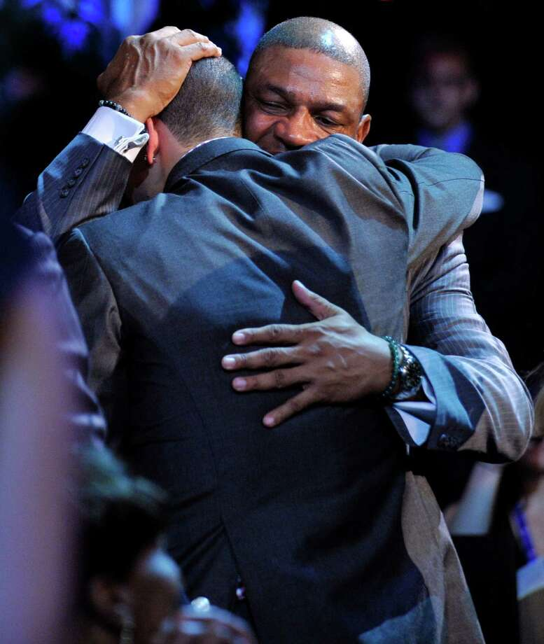 Boston Celtics head coach Doc Rivers, rear, hugs his son, Duke's Austin Rivers, after Austin was selected as the No. 10 overall draft pick by the New Orleans Hornets in the NBA basketball draft, Thursday, June, 28, 2012, in Newark, N.J. Photo: Bill Kostroun, AP / FR51951 AP