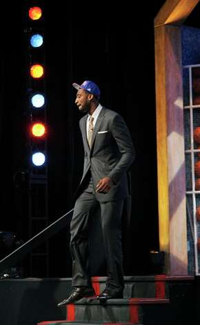Connecticut's Andre  Drummond walks from the stage as the No. 9 overall draft pick selected by the  Detroit Pistons in the NBA basketball draft, Thursday, June, 28, 2012,  in Newark, N.J. (AP Photo/Bill Kostroun)