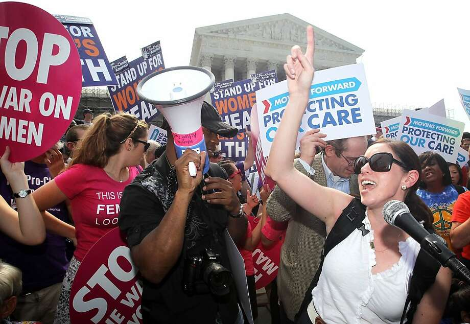 WASHINGTON, DC - JUNE 28:  Local resident Angela Botlicella (R), along with other Obamacare supporters, celebrate as they respond to the Supreme Court ruling on the Affordable Health Act June 28, 2012 in front of the U.S. Supreme Court in Washington, DC. The Supreme Court has upheld the whole healthcare law of the Obama Administration.  (Photo by Alex Wong/Getty Images) Photo: Alex Wong, Getty Images
