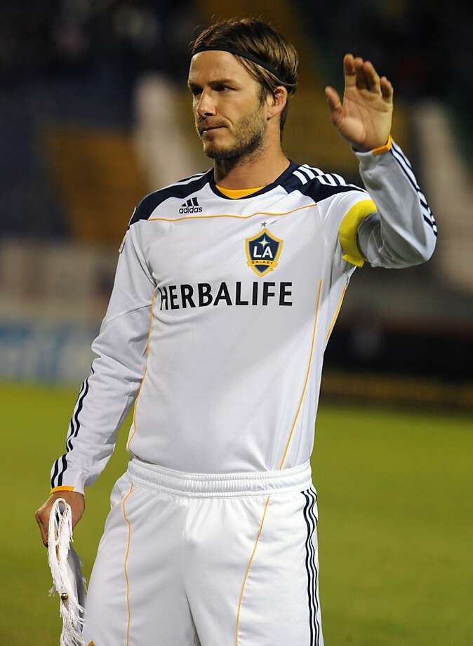 (FILES) This file photo taken on October 20, 2011 shows British David Beckham of the US Los Angeles Galaxy gesturing before the game against Honduras' Motagua in a Concacaf Championship League football match, at the Tiburcio Carias Andino Stadium in Tegucigalpa.  David Beckham's dream of playing in the Olympics he helped secure for his hometown came to an end on June 28, 2012 after he was left out of Great Britain's squad for the Games.  AFP   PHOTO / Orlando SIERRAORLANDO SIERRA/AFP/GettyImages Photo: Orlando Sierra, AFP/Getty Images