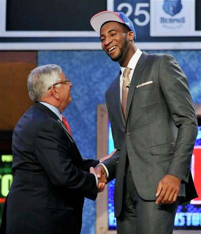 NBA Commissioner David Stern, left, poses with the No. 9 overall draft pick Andre Drummond,  of Connecticut, who was selected by the Detroit Pistons in the NBA  basketball draft, Thursday, June, 28, 2012, in Newark, N.J. (AP  Photo/Bill Kostroun)