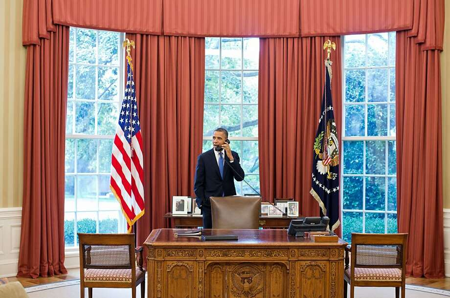 """President Barack Obama talks with Solicitor General Donald Verrilli after learning the Supreme Court's ruling on the """"Patient Protection and Affordable Care Act,"""" Wednesday, June 28, 2012, in Washington, D.C. (Pete Souza/White House/MCT) Photo: Pete Souza, McClatchy-Tribune News Service"""