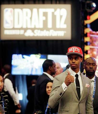 Connecticut's Jeremy Lamb gestures moments after being selected No. 12 by the Houston Rockets  during the NBA basketball draft, Thursday, June 28, 2012, in Newark,  N.J. (AP Photo/Julio Cortez)