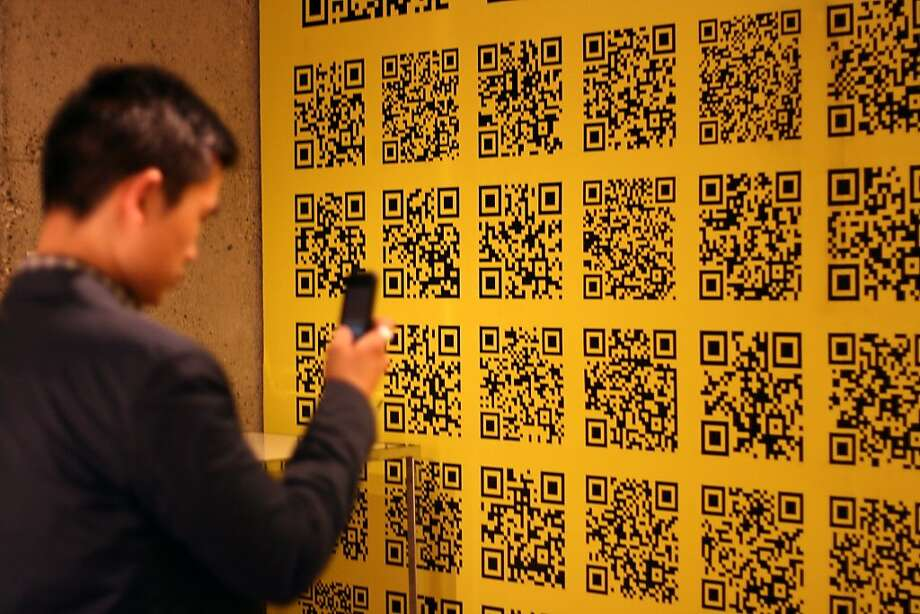 Wallpaper with QR codes can take you to a variety of websites. Photo: Victoria Crottick, Rollout.ca