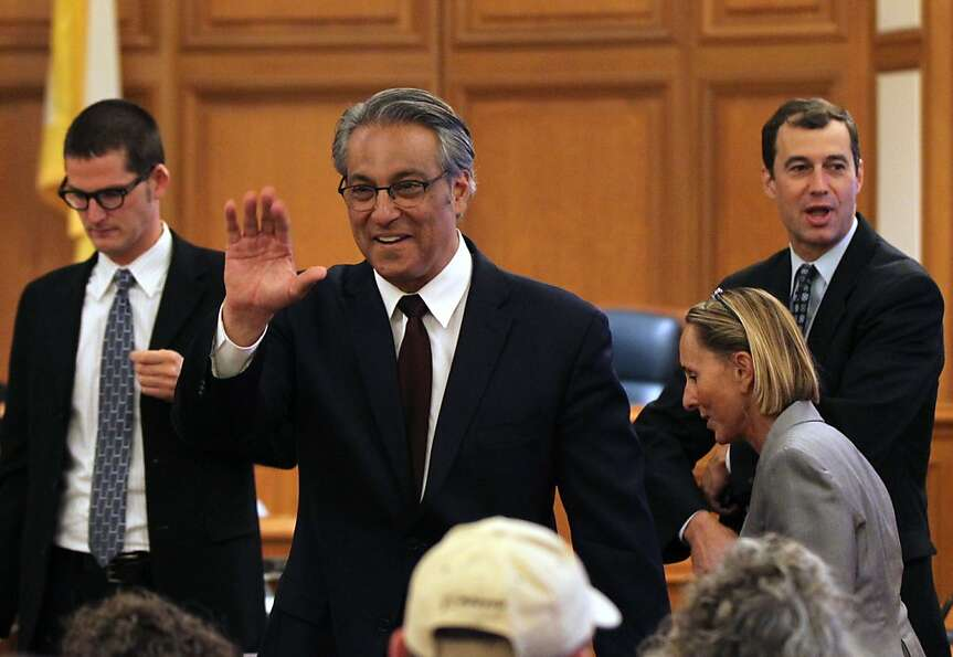 Ross Mirkarimi center greets supporters prior to the start of the Ethics Commission hearing at San F