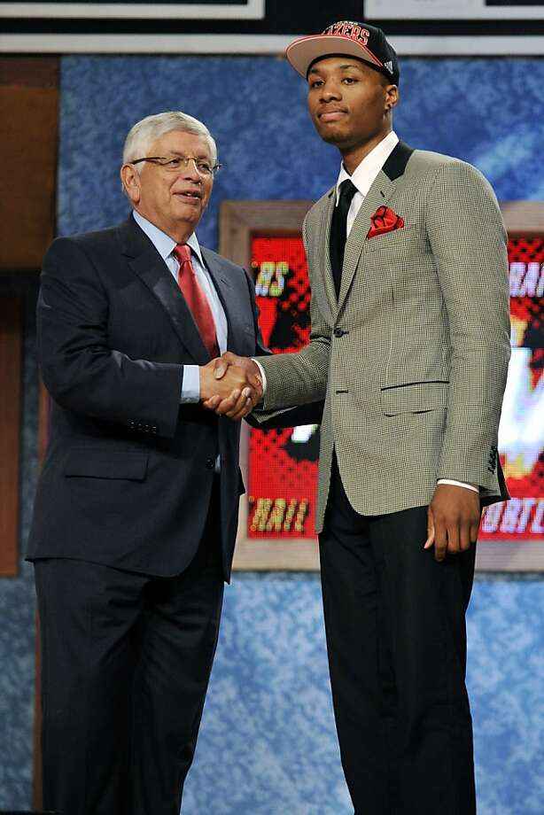 NBA Commissioner David Stern, left, poses with the No. 6 overall draft pick Damian Lillard, of Weber State, who was selected by the Portland Trail Blazers in the NBA basketball draft, Thursday, June, 28, 2012, in Newark, N.J. (AP Photo/Bill Kostroun) Photo: Bill Kostroun, Associated Press