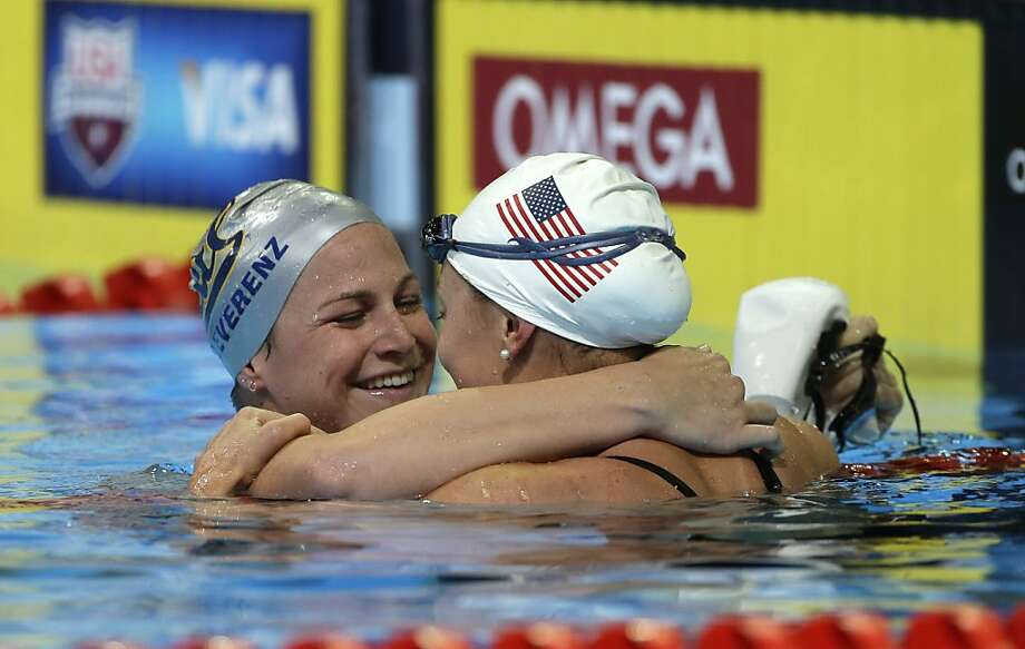 Caitlin Leverenz hugs Ariana Kukors after swimming in the women's 200-meter individual medley final at the U.S. Olympic swimming trials on Thursday, June 28, 2012, in Omaha, Neb. (AP Photo/Mark Humphrey) Photo: Mark Humphrey, Associated Press
