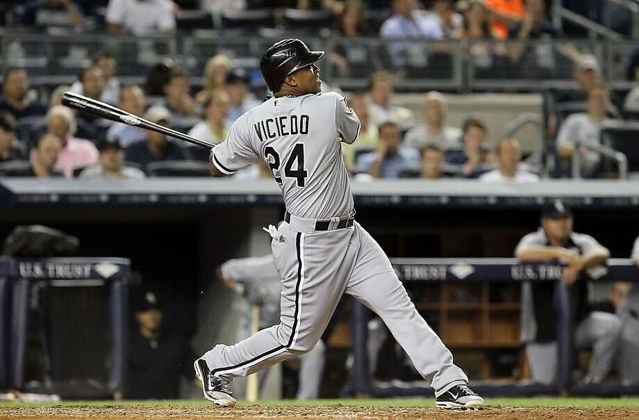 NEW YORK, NY - JUNE 28:  Dayan Viciedo #24 of the Chicago White Sox follows through on his ninth inning three run home run against the New York Yankees at Yankee Stadium on June 28, 2012  in the Bronx borough of New York City.  (Photo by Jim McIsaac/Getty Images) Photo: Jim McIsaac, Getty Images