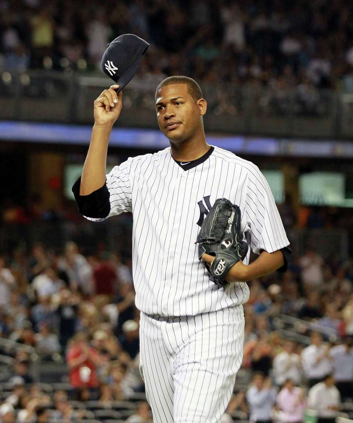 NEW YORK, NY - JUNE 28: Ivan Nova #47 of the New York Yankees tips his cap as he leaves the game against the Chicago White Sox in the eighth inning at Yankee Stadium on June 28, 2012 in the Bronx borough of New York City. (Photo by Jim McIsaac/Getty Images)