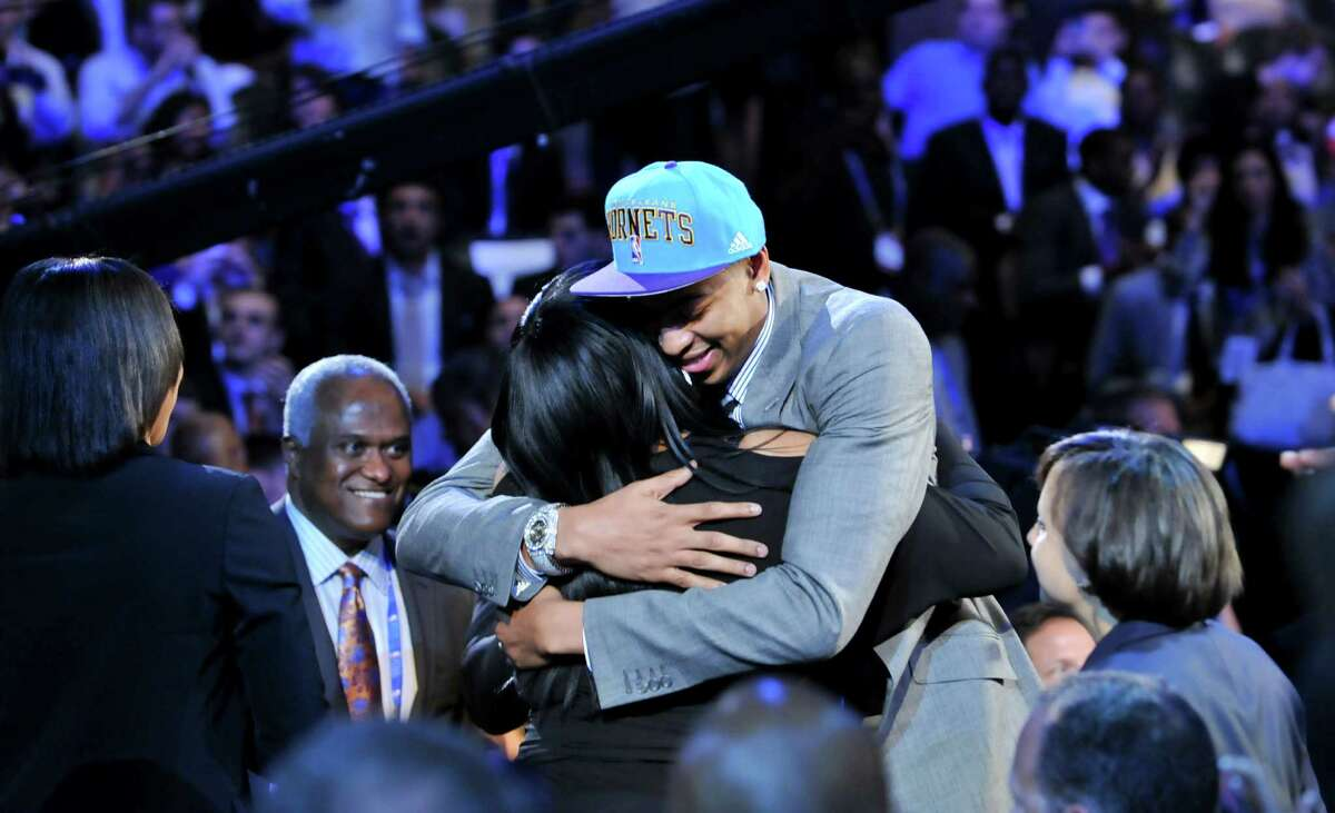 Former University of Kentucky Wildcats player Anthony Davis, right, embraces his mother after Davis was selected as the first pick in the 2012 NBA Draft by the New Orleans Hornets, at the Prudential Center in Newark, N.J., June 28, 2012. (Jason Szenes/The New York Times)