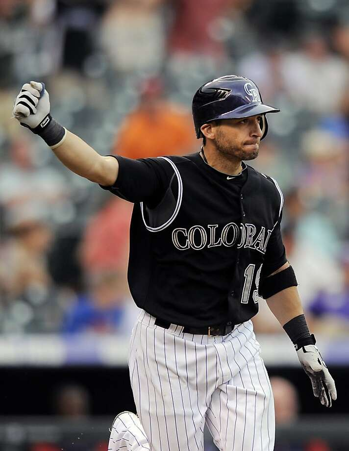 Colorado Rockies Marco Scutaro celebrates his game-winning hit in the 11th inning of a baseball game against the Washington Nationals, Thursday, June 28, 2012, in Denver. The Rockies won 11-10. (AP Photo/Chris Schneider) Photo: Chris Schneider, Associated Press