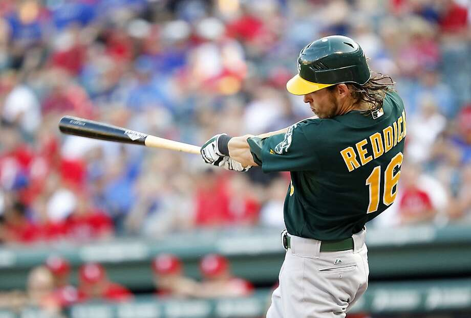 ARLINGTON, TX - JUNE 28: Josh Reddick #16 of the Oakland Athletics hits a home run in the first inning against the Texas Rangers at Rangers Ballpark in Arlington on June 28, 2012 in Arlington, Texas. (Photo by Rick Yeatts/Getty Images)(Photo by Rick Yeatts/Getty Images) Photo: Rick Yeatts, Getty Images