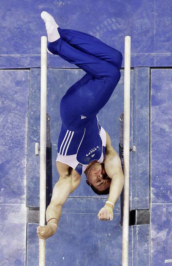 Alex Buscaglia competes on the parallel bars during the preliminary round of the men's Olympic gymnastics trials Thursday, June 28, 2012, in San Jose, Calif. Photo: Julie Jacobson, Associated Press / AP