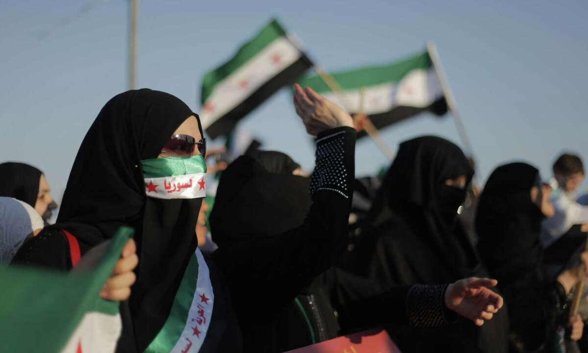 A veiled Syrian woman chants slogans against President Bashar Assad, during a protest in front the Syrian embassy in Amman, Jordan, Thursday, June 28, 2012. (AP Photo/Mohammad Hannon)
