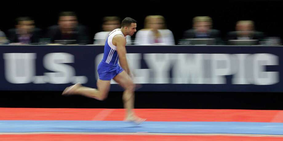 Danell Leyva makes his approach to the vault during the preliminary round of the men's Olympic gymnastics trials Thursday, June 28, 2012, in San Jose, Calif. Photo: Jae C. Hong, Associated Press / AP