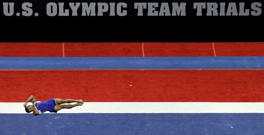 Jacob Dalton performs in the floor exercise event during the preliminary round of the men's Olympic gymnastics trials Thursday, June 28, 2012, in San Jose, Calif. Photo: Gregory Bull, Associated Press / AP