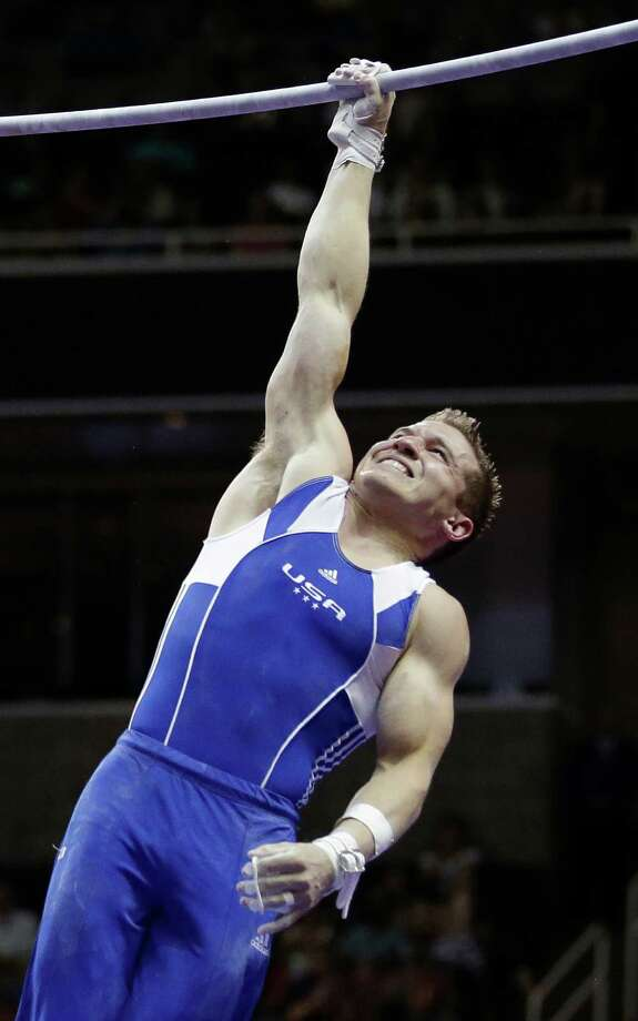 Jonathan Horton performs a one-arm giant on the horizontal bar during the preliminary round of the men's Olympic gymnastics trials Thursday, June 28, 2012, in San Jose, Calif. Horton stands in fourth place after the preliminaries. Photo: Gregory Bull, Associated Press / AP