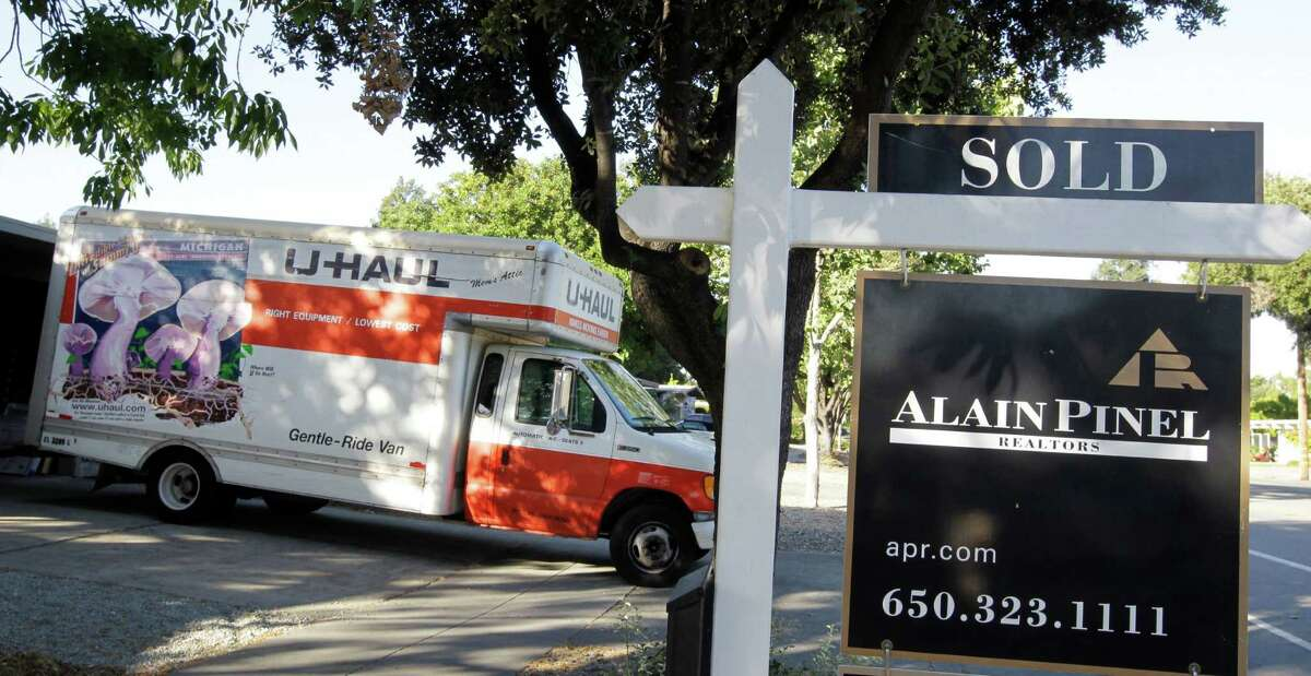 A moving truck is shown at a house that was sold in Palo Alto, Calif., Tuesday, June 19, 2012. A new survey shows more than half of Californians are considering leaving the state.