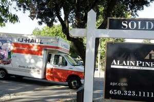 A moving truck is shown at a house that was sold in Palo Alto, Calif., Tuesday, June 19, 2012. The average U.S. rate on the 30-year fixed mortgage stayed this week at the lowest level on record. (AP Photo/Paul Sakuma)