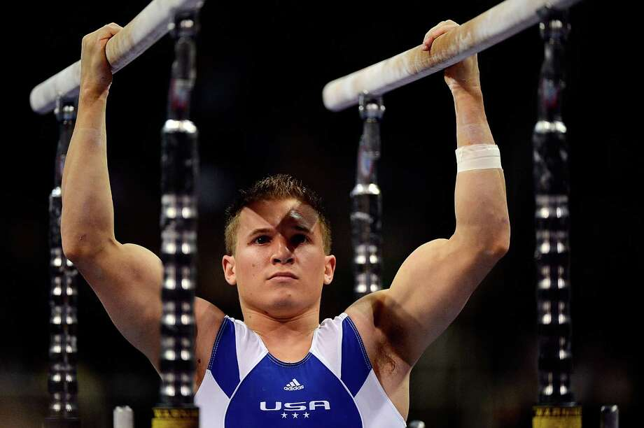 Jonathan Horton prepares before competing on the parallel bars during day 1 of the 2012 U.S. Olympic Gymnastics Team Trials at HP Pavilion on June 28, 2012 in San Jose, California Photo: Ronald Martinez, Getty Images / 2012 Getty Images