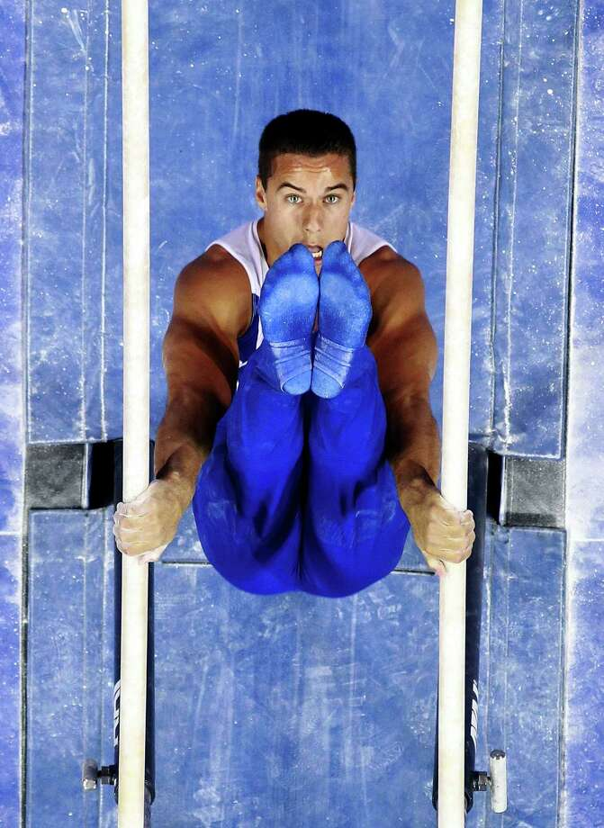 Jake Dalton competes on the parallel bars during day 1 of the 2012 U.S. Olympic Gymnastics Team Trials at HP Pavilion on June 28, 2012 in San Jose, California. Photo: Ronald Martinez, Getty Images / 2012 Getty Images